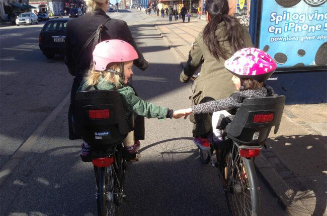 Mother riding with children in the bike city