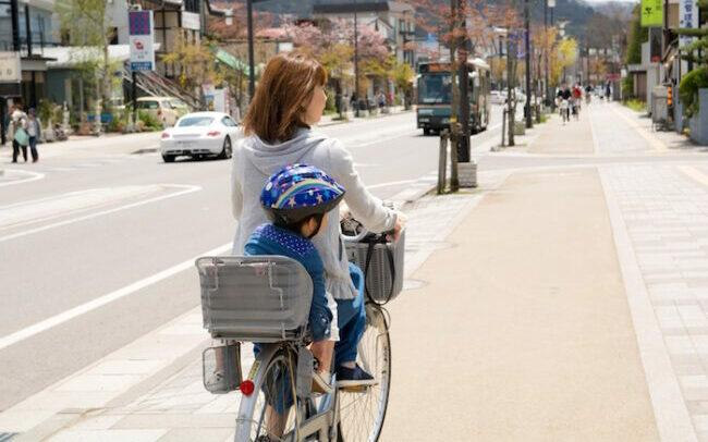 mother-and-son-biking as post feature image of best price electric bikes below 1000.